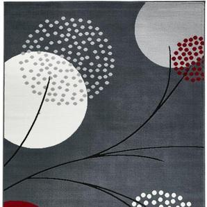 Teppich mit stilisierten Blüten grau