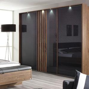 3-trg. Schwebetürenschrank in Eiche Stirling-NB mit Glasfront in basalt-grau, 2 Einlegeböden, 2 Kleiderstangen, Maße: B/H/T ca. 271/210/62 cm