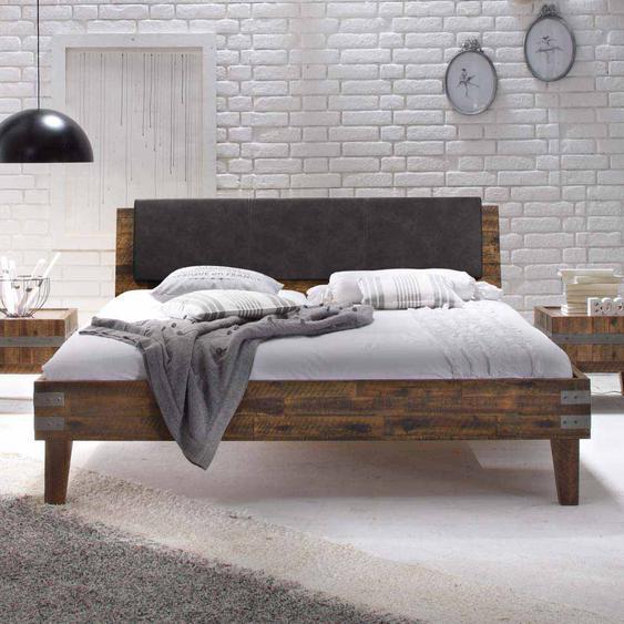 Bett in Braun Akazie massiv Polster am Kopfteil