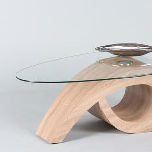Couchtisch in Sonoma Eiche-Nachbildung, mit einer ovalen Glastischplatte aus Klarglas, Maße: B/H/T ca. 120/41/70 cm