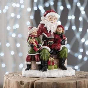 Dekorationsfigur Weihnachtsmann liest Geschichte