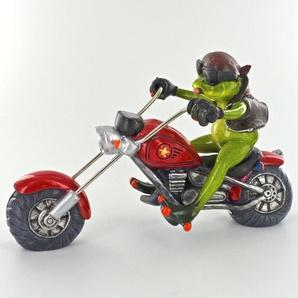 Figur Frosch mit Humor auf dem Motorrad