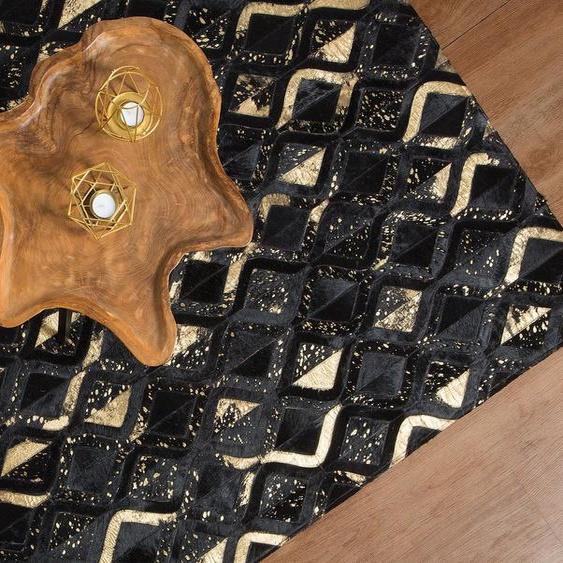Teppich Kuhfell schwarz-gold 140 x 200 cm ZickZackmuster DEVELI